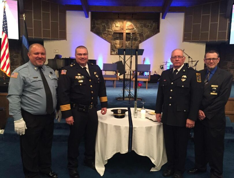 Allen County Master Deputy Darren Kellerman, McPherson Police Chief Robert McClarty and Police Department Chaplains Dick Reynolds and David Kessler at the Missing Man table.