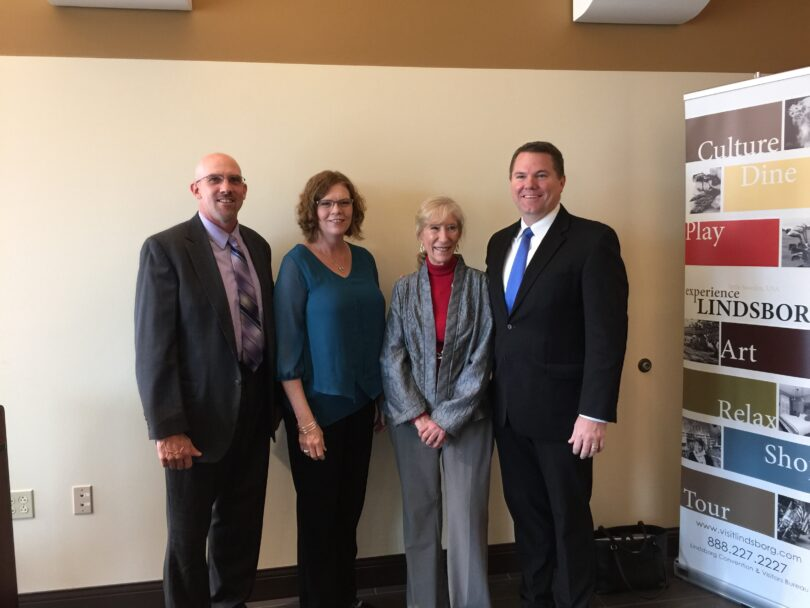 On hand for the gift reveal were Lindsborg Community Hospital Administrator Larry Van Der Wege, McPherson County Community Foundation CEO Becky Goss, Nutt's cousin Loutricia Walleen and Bethany College President Will Jones at the J.O. Sundstrom Conference Center in Lindsborg Monday.